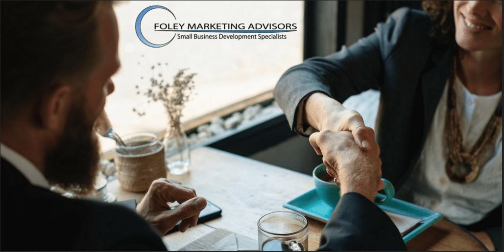business people meeting Foley Marketing Advisors