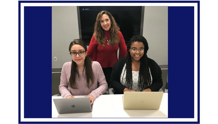 women at laptops